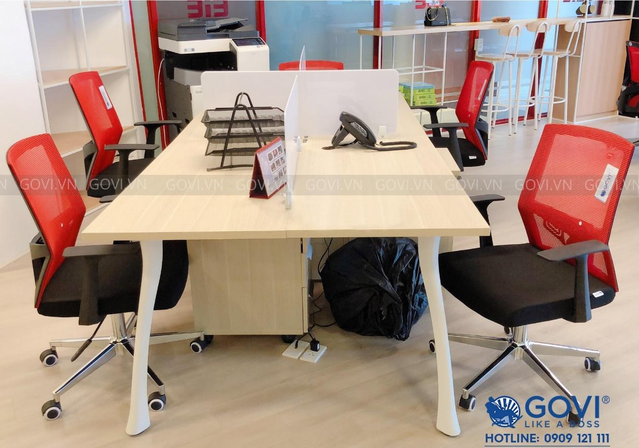 A desk with a red chair  Description automatically generated