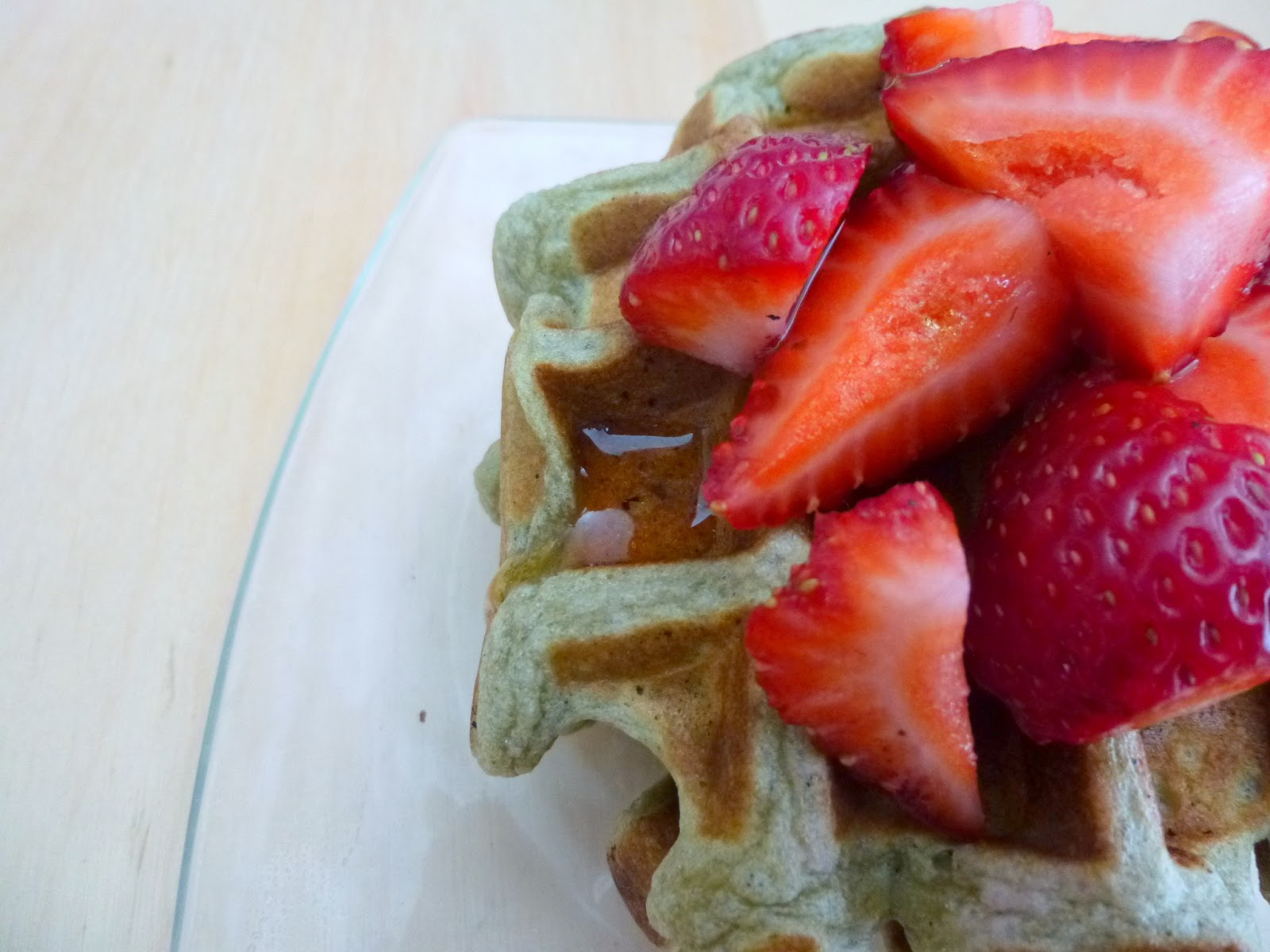if you want to insert matcha into even more areas of your life, these matcha waffles (topped with maple syrup and strawberries) are perfect.