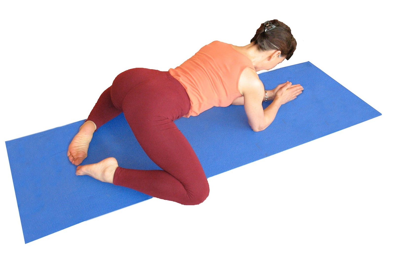 lillah schwartz practicing Kneeling Groin Stretch yoga pose as therapeutic yoga for back pain