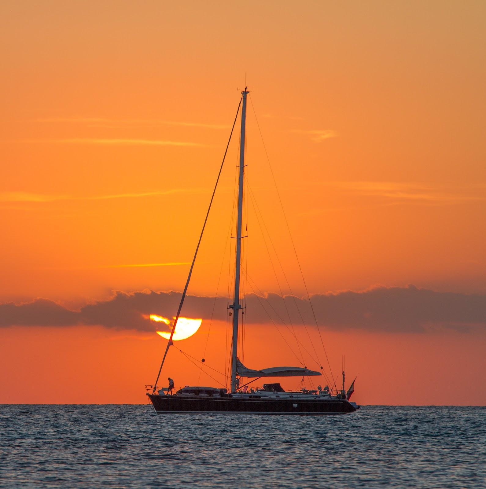 sunrise and sailboat