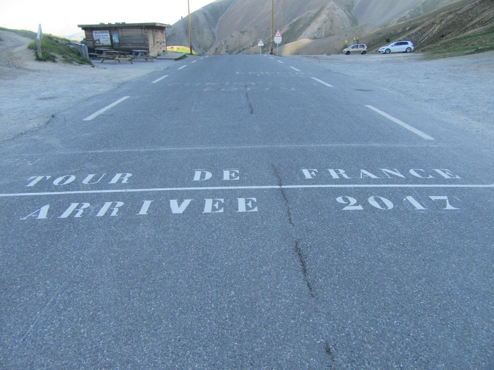 Bicycling to Col d'Izoard Guillestre - Tour de France writing on roadway at the col