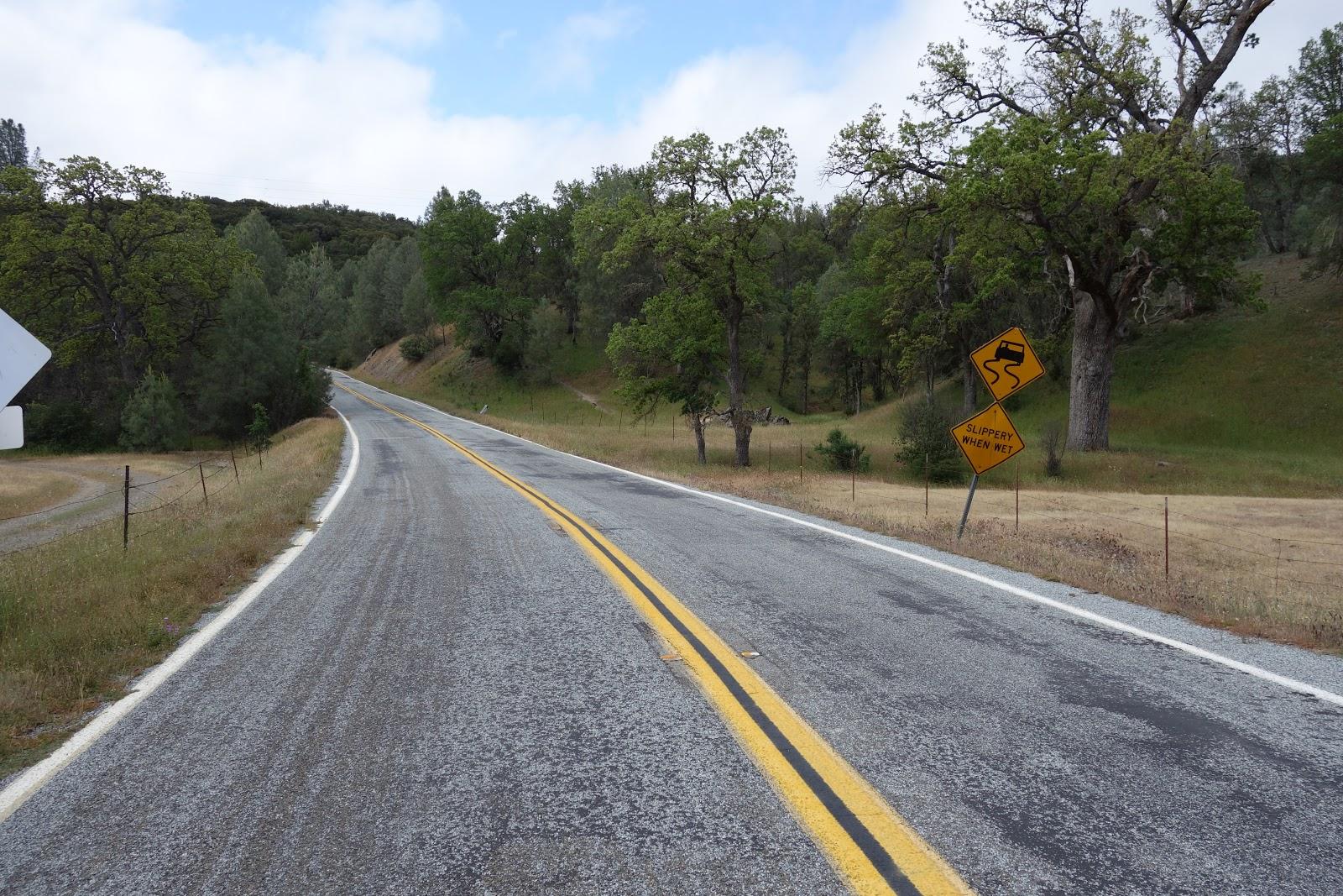 Beginning of Mt. Hamilton East road bike climb - road sign and road.
