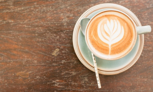 A hot cappuccino is commonly drank in a cafe in Italy before work.