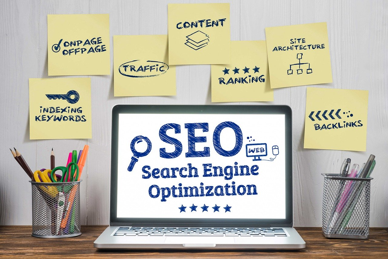 """A laptop on a desk with the words """"Search engine optimization"""" on the screen"""