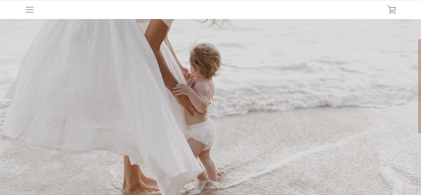 Modern Market's landing page - a woman holding a toddler on a beach
