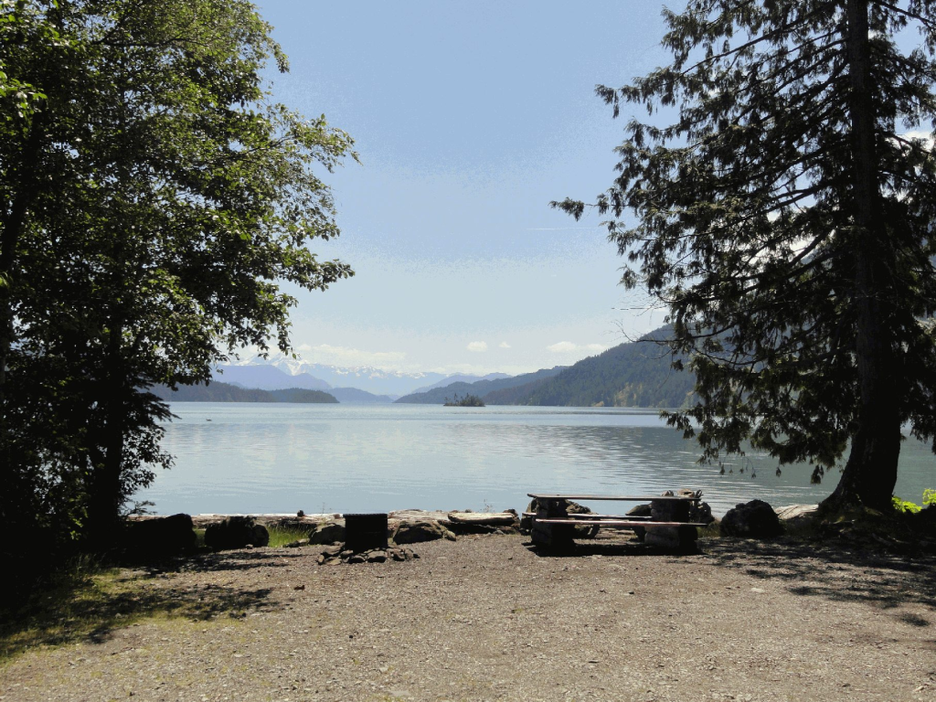 looking out onto Harrison Lake from chairs on Twenty Mile Bay's beach