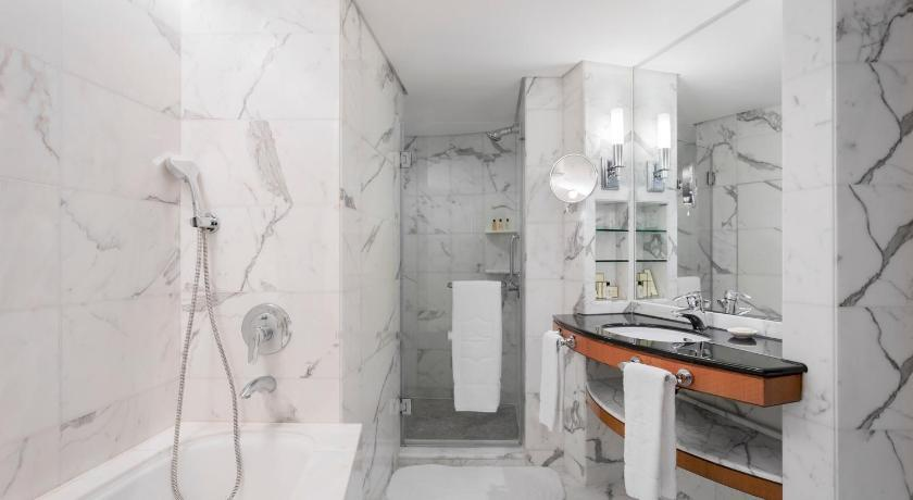 A Picture Containing Indoor, Wall, Floor, Toilet  Description Automatically Generated