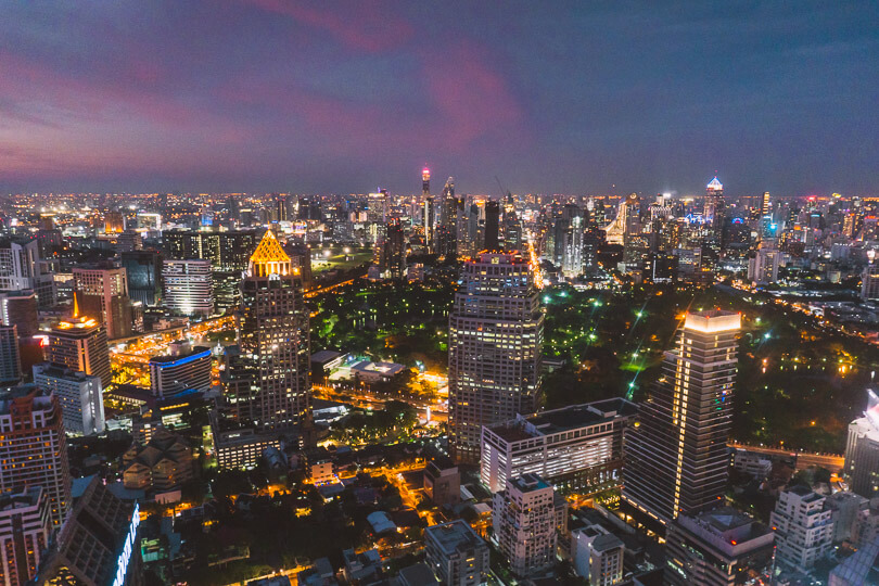 Looking out over Bangkok's skyline from Hi-SO Sofitel rooftop bar in Bangkok.