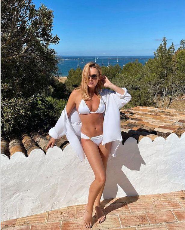 Amanda Holden has showed off her enviable figure in a white bikini