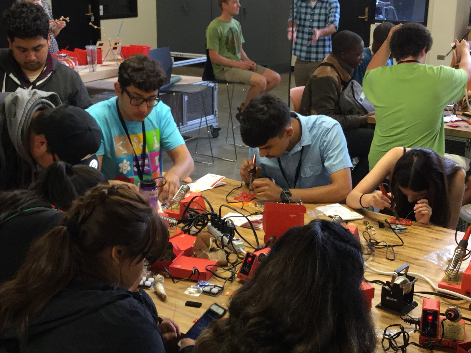 EngiNearMe students solder circuit boards during the bridge program