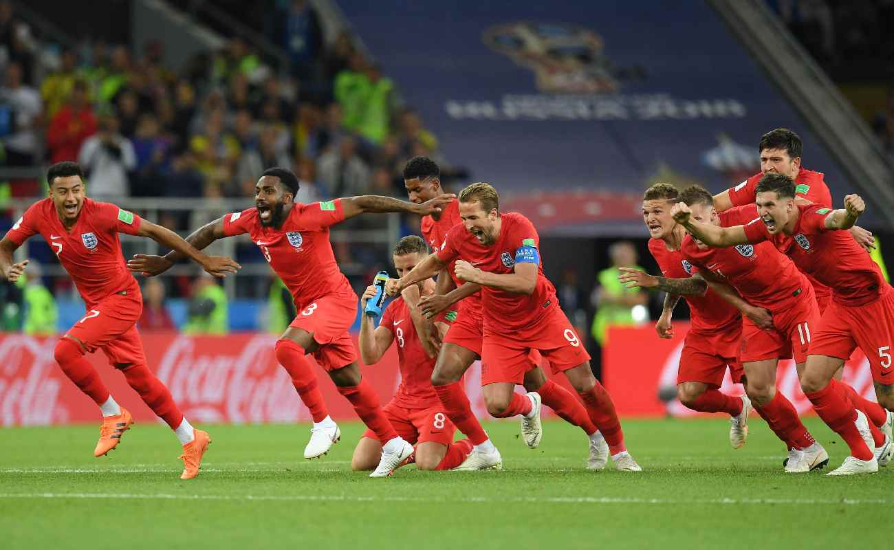 Alt: The English soccer team celebrates after scoring a penalty - Photo by Matthias Hangst/Getty Images