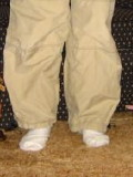 A pair of legs in cargo pants