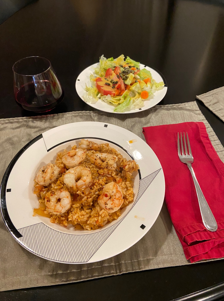 This image has an empty alt attribute; its file name is spicy-shrimp-with-spanish-rice-photo.jpg