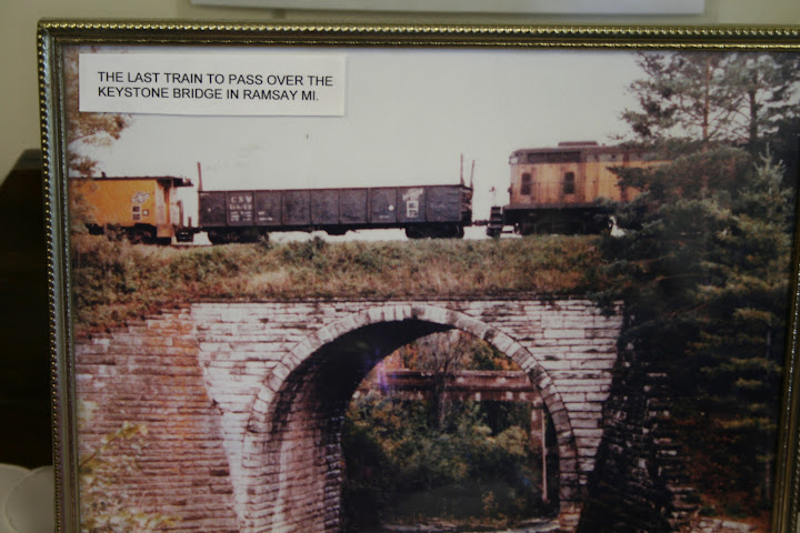 This is an image taken of a photo of the Keystone Bridge located in the Bessemer Heritage Museum. The bridge is considered to be the second largest in the world. When looking at the bridge, it is evident the amount of craftsmanship executed in the construction of the structure. The bridge is used primarily used for rail cars and was constructed by the The Chicago and Northwestern Railway Company in 1891- Ashley Holloway