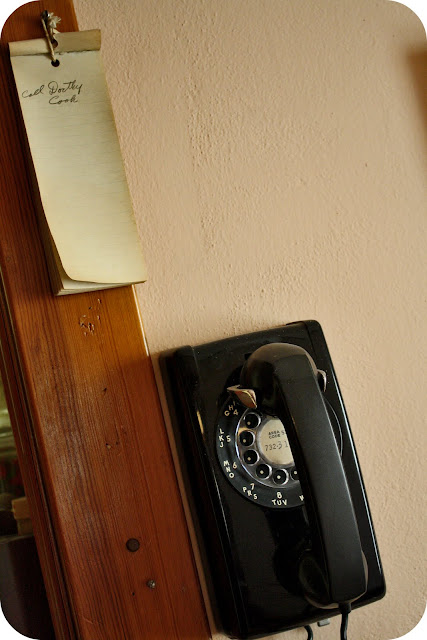 old telephone and note on wall