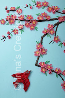 Cherry blossom and a flying bird