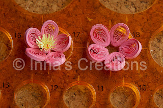 Quilled flowers in a circles template