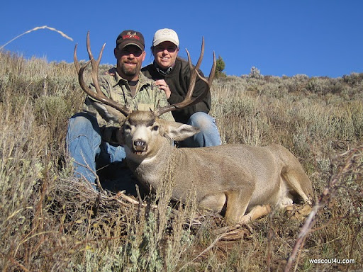 "Bob and Susan Thurman hunted our Willow Creek Lease in 2007. Opening day, Bob shot this 27""+ buck at a measured 500+ yards. Good shootin' Bob!"