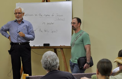 Lester Hall and Luke Wilson debating salvation.
