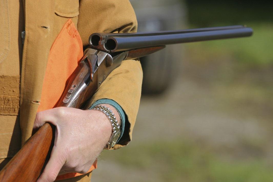 unloaded shotgun over the arm