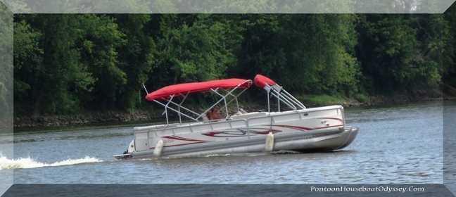 A nice looking pontoon boat making it's way up the Muskingum River in central Ohio.