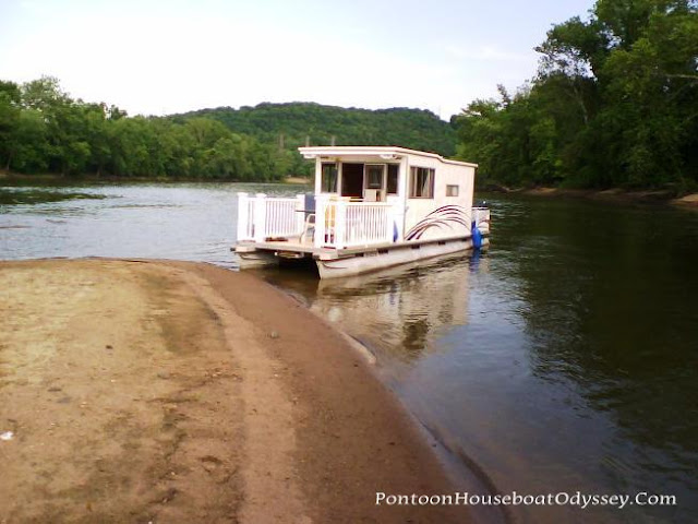 """Our restored Crest pontoon house boat resting on a sandbar on the Muskingum River waiting for the Philo locks to open."""""""