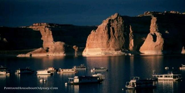 A loose peaceful gathering of houseboats with a view of the cliffs surrounding the shore