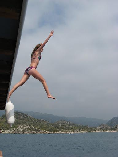 girl leaps off boat near Kekova, Kalkan, Turkey