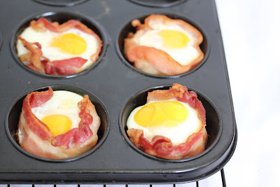 photo of four Bacon Egg Toast Cups in a muffin tin