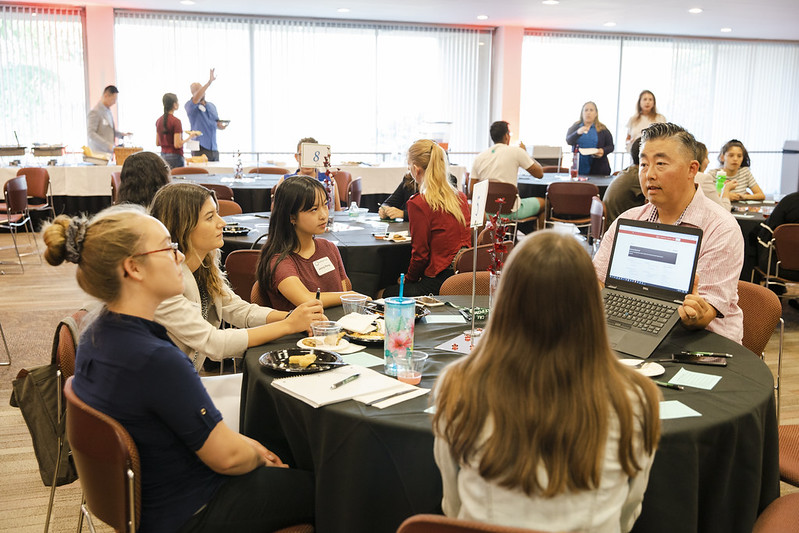 Students speaking to a mentor during ASI Speed Mentoring event