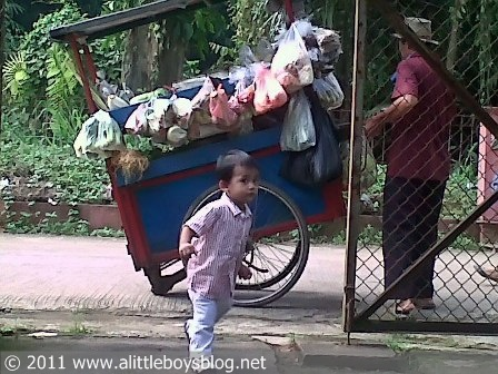 Baby and vegetable pushcart vendor