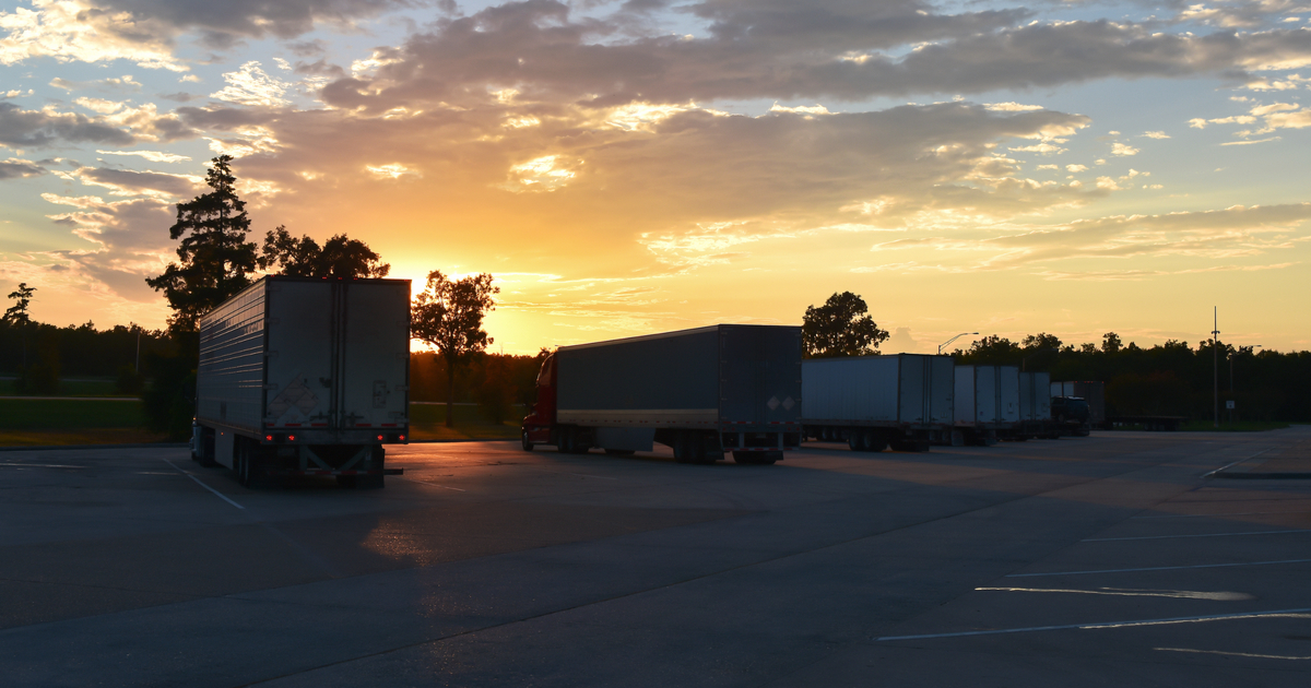 Truckers at sunset using the COVID-19 CARES ACT stimulus money.