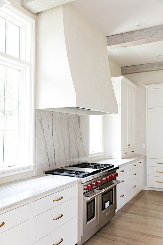 plaster hood natural stone whitewshed exposed beams classic white kitchen tara fust design buckhead