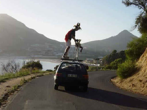 Extreme Ironing On A Car Roof