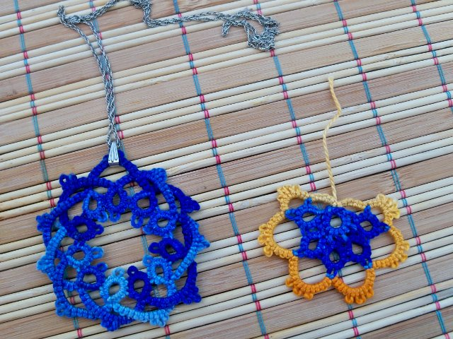 blue pendant and orange and blue doodle
