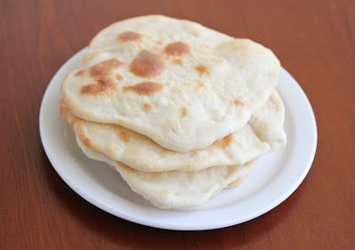 close-up photo of a stack of naan