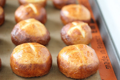 photo of pretzel rolls on a baking sheet