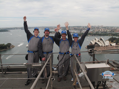 Travis, Derek, and a couple of locals on the Sydney Harbour bridge climb.