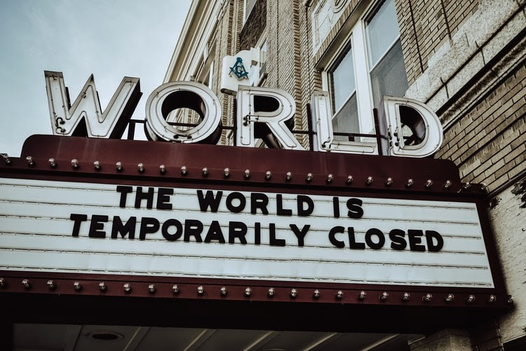 sign with text The World is Closed