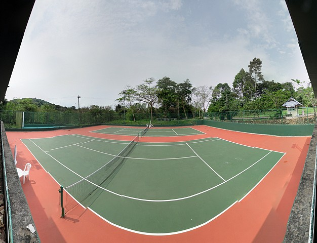 Newly resurfaced tennis courts and practice wall