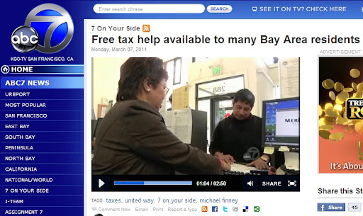 Northeast Community FCU CEO Lily Lo assists a member with free tax preparation at the CDCU's VITA Site in their Tenderloin branch.