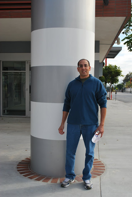 This is a photo of Anand standing in front of the gizmo gadget in Port of San Pedro, CA.