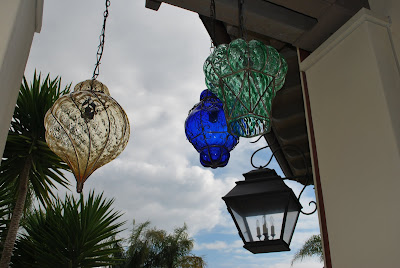 This is a photo of glass Morrocan Hanging Lamps hanging by the pool area.