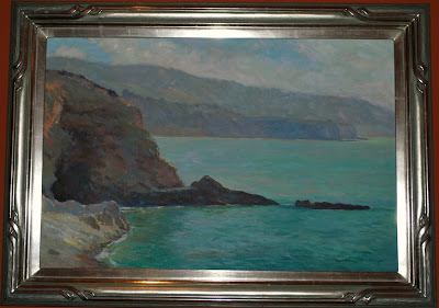 This is a photo of an oil painting (Plein Air Painting of the Cove at Terranea Resort, Palo Verda, CA.)