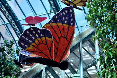 This is a photo of a handcrafted butterfly that hangs from the ceiling inside the Conservatory of the Bellagio Hotel and Casino, Las Vegas, NV.