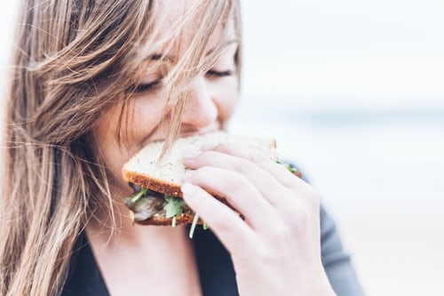 girl eating negative food item according to whole30