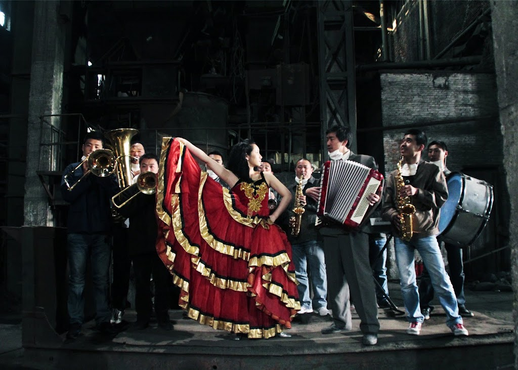 Chen (Wang Qian-yuan) and his band of factory workers perform in Zhang Meng's THE PIANO IN A FACTORY