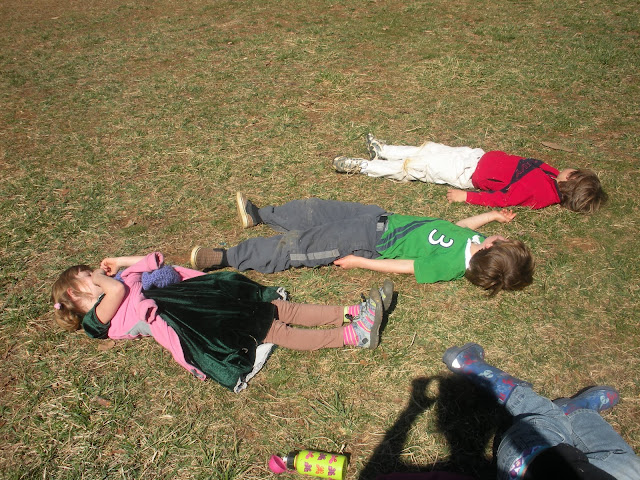 Thumbs-Up Kids doing Savasana - deep relaxation on a nice spring day!