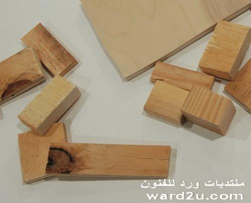 برواز مرايا من قطع الخشب