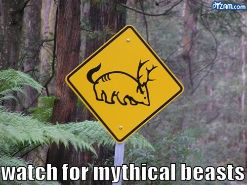 funny road sign warning of mythical creatures
